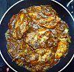 Le poulet en cours de cuisson