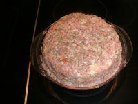 La pâte dans son plat prêt à être mis au four